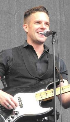 Brandon Flowers is literally perfect. ugh <3.