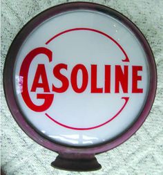 We buy, sell, and appraise Gasoline Globe Porcelain Signs.