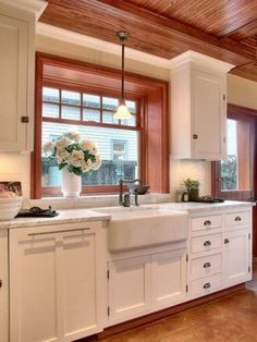 I love the mixture of wood and white, and how the kitchen is farmhouse-y but modern.