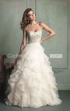 but will it keep the girls in?? Worth a try!!!!!Not too much bling or poof fitted upper body. Strapless. #weddingdress