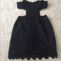 Black cutout dress with embroidery detail. Black cutout dress with beautiful embroidered material running along the middle (both front and back). This dress gives a nice shape to anyone because of the cutout position. Could fit a small or medium. Very sexy! Great for summer! Twelve by Forever  Dresses Midi