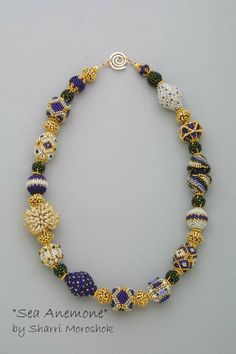 """""""Sea Anemone"""" was one of my early pieces designed around the spiky Sea Anemone beaded bead. www.TheBeadedBead.etsy.com"""