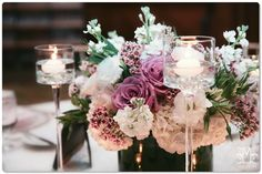 Romantic Ivory and Plumb Centerpieces #ceremonydecor #ceremonyflowers  Venue - The Four Seaons North Scottsdale Photography - Marriott Photography Wedding Planner - Charlee Gesier