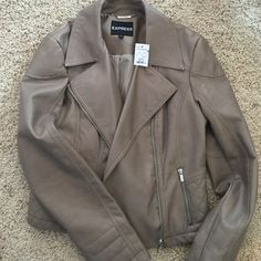 Express Moto Style Jacket Gorgeous!! NWT Brand new! taupe/brown minus the leather moto style jacket with quilted accents and lots of zippers. Lightly lined. So stylish! super deal! Express Jackets & Coats