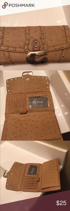 New. Guess wallet. Tan leather with silver studs This checkbook holder and pen holder  very nice it's new Guess Bags Clutches & Wristlets