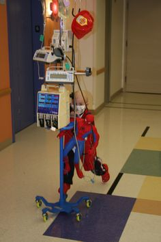 """Ethan Lent was diagnosed at 5 years old. He is seen here """"riding"""" his IV pole in the hospital hallway. His mother Johanna Lent sent us this photo, and writes: """"Ethan beat the odds, and is now a healthy 10 year old boy!"""""""