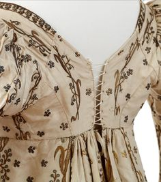 "Court dress and train owned by Empress Josephine, First Empire From the Chateau de Malmaison Costume Collection app: "" ""This court outfit, sumptuously embroidered with lotus flowers in cannetille,..."