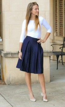 Navy mid length office style pleated skirt with hidden back zipper available in S-XL
