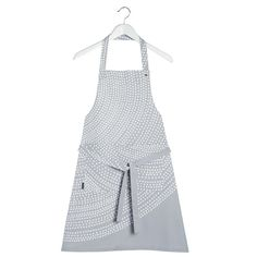Marimekko Fokus Apron in soft grey and white....Shades of Grey, very on trend and this concentric circle design is very pleasing to the eye, this heavy duty cotton apron has adjustable neck strap and a deep pocket to put utensils or hang your tea towels and things from, working in the kitchen has never looked so stylish. A mothers day gift for those keen cooks.
