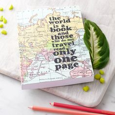 A beautiful map travel journal covered in a vintage world map and a quote to inspire exploration & perfect as a gift for travellers.