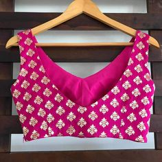 Hot pink brocade blouse with side zip. Sleeves can be added on request. Simple Kurta Designs, Fancy Blouse Designs, Blouse Neck Designs, Blouse Patterns, Stylish Blouse Design, Stylish Dress Designs, Pink Saree Blouse, Sleeveless Blouse, Peach