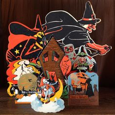 Crooked old houses with lots of witch activity - broom piloting, spell casting. a group of haunted cottages and wild witch imagery in paper and tin from the to Halloween Items, Halloween Trick Or Treat, Halloween 2015, Spirit Halloween, Halloween Treats, Happy Halloween, Halloween Witches, Charlie Brown Halloween, Vintage Halloween Decorations