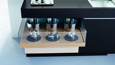 Poggenpohl +MODO black & mineral white cabinet trays with glass