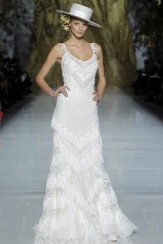 A look from the Pronovias Spring 2014 preview show in Barcelona. [Photo Courtesy of Pronovias]