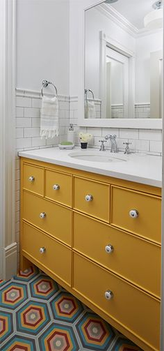 Colorful bathroom design with yellow vanity and tile floor design | 2to5 Design