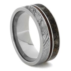 Extraordinary elements align in this magnificent meteorite wedding band. Mirrored to the meteorite is genuine dinosaur bone from the Jurassic Era. Splitt...