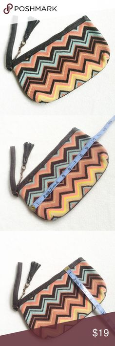 Missoni for Target Tassel Clutch Missoni for Target Tassel Clutch. Like new! Used once on vacation but you can't tell at all. Beautiful colors, amazing knit, brown faux leather detailing & fringe tassel accent. Very Nice Clutch! Missoni Bags Clutches & Wristlets