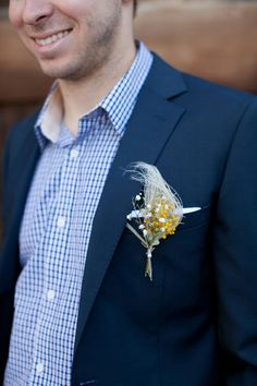 floral and feather boutonniere // photo by Love Janet Photography