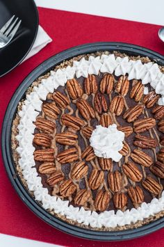 A no bake Chocolate Caramel Pecan Pie that is raw vegan, gluten-free, & paleo. Perfect to suit any food preferences these holidays! Incredibly easy to make.