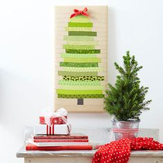 Have a merry Christmas with eye-catching wall art sporting rows of pieced fabrics that create an abstract tree. Sew a green fabric strip between two solid tan strips for each row, then join the rows to form the tree. Stretch the fabric over an artist's canvas, and it's ready to hang.