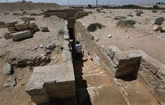 Egyptian antiquities experts walk down the stairs of a royal tomb entrance at the ancient city of Leukaspis a well known Greco-Roman port ov...