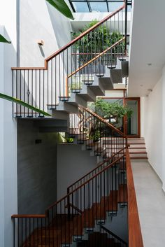 architects clads vietnamese office building in dynamic façade and greenery Interior Architecture, Interior And Exterior, Interior Ideas, Interior Design, Ocean Park, Roof Plan, House Stairs, Modern Staircase, Tropical Houses