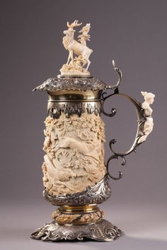 A 19th Century German Carved Ivory and Silver Tankard.
