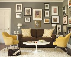 Brown And Yellow Living Room With Warm Gray Walls Eclectic Art Gallery Chocolate Velvet Sofa Zebra Pillows Vintage Chairs