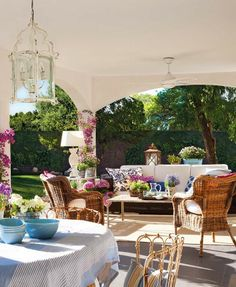 Fabulous porch....lots of plants, dining area, open to outside.