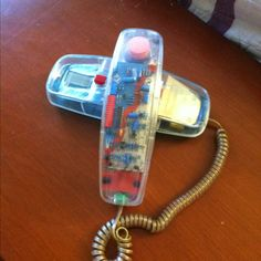 True 90s kid. :)  see thru phone that lights up...me and my friends had them.