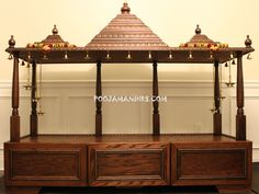 Custom Pooja Mandirs, Made in the USA (Cary, North Carolina). This is a gorgeous temple built with a lot of storage space and has an elegant look that gives a grand appearance to your pooja room. This is best suited for large pooja rooms and provides ample space to keep many idols and pictures of gods and mahatmas.