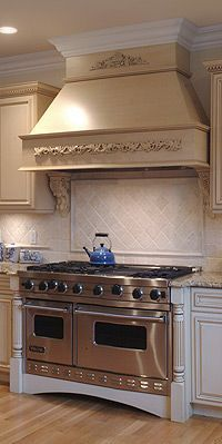 Wood Range Hoods by Stanisci Design #kitchensource #pinterest #followerfind