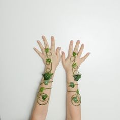 This listing is for two poison ivy arm cuffs (only sold as a set). The cuff and ring part are adjustable and the wire wraps around the arm.