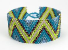 RESONANT Seed Bead Bracelet - Peyote Stitch Bracelet - Hand Beaded Jewelry - Bead Weaving - Zig Zag Pattern - Chevron Stripes - Colorful by LunamagicK on Etsy https://www.etsy.com/listing/196508077/resonant-seed-bead-bracelet-peyote
