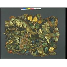 Embossed gilt leather panel, with a pattern in high relief of scrolling foliage with fruit and flowers, on which some swallows are perched. The pattern in gold and heightened with green and blue glazes on a brown ground. The high relief on the back is filled with woodpulp /Jaques Dulud ca. 1850