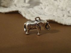 Small silver colored vintage style elephant charm by BuyDiy, $5.95