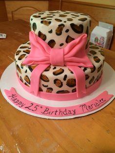 Cheetah print 25th birthday cake.  Fondant bow - hand-painted cheetah spots.