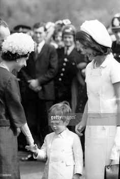 Queen Elizabeth II of Great Britain with John Kennedy Jr. (1960 - 1999), son of the late President John F Kennedy, and Jackie Kennedy during the inauguration of Britain's Kennedy memorial at Runnymede. (Photo by Wesley/Keystone/Getty Images)