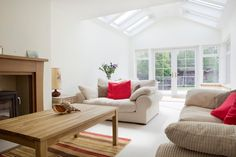 Create an atrium affect in your home extension with stylish white VELUX roof windows. Save money when you shop at Sterlingbuild. Image via…