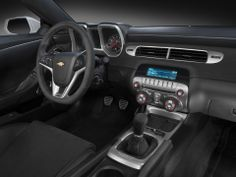 The 2014 Chevrolet Camaro Z28's interior has Z/28-specific matte-metallic trim called Octane and a flat-bottom steering wheel. There is less sound deadening and no rear pass-through to save weight.