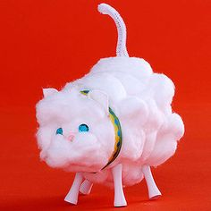 This super-soft, cuddly kitten is made from a paper cup and a few golf tees, plus oodles of cotton balls.                 Make it: Cover a white cup with cotton balls, then help your child glue on sequin eyes and a cute button nose. Poke a hole in the bottom of the cup with a white chenille stem to create a tail. Turn the cup on its side, and add legs by gently poking four golf tees into the side of the cup. To create the ears, make small incisions in the cup. Cut out small squares of white…