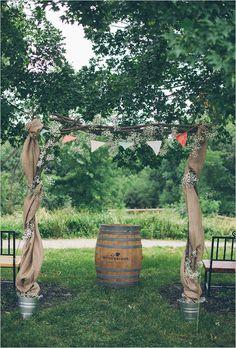 Wedding ceremony arch with bunting and burlap. #weddingdecor #ceremonyideas #weddingchicks Captured By: Studio127 Photography ---> http://www.weddingchicks.com/2014/04/29/a-wedding-cake-dilemma/