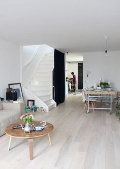 white wash wood floors (and a cool staircase)