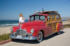 Classic late-forties Pontiac surf woody makes the beach scene.