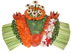 Vegetables Apeeling  Colorful crafted works of art will astound everyone. Fresh carved vegetables displayed in many different arrangements. You select the vegetables and we will craft yiu a work of art. Heart shaped designs are also available.
