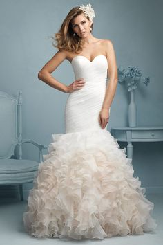 Allure Bridals 9223 - Your search for an unforgettable gown is over. This strapless gown's softly ruched bodice trails to a playful ruffled skirt, with a flair for drama and elegance.