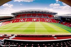 This is a well taken photo on a football field (anfield) as you can see that the photo is taken at noon time as you and see most of the sunlight on the pitch. The color of the seat does goes together (red and whight) it is really cool on how there make it on a big scale.