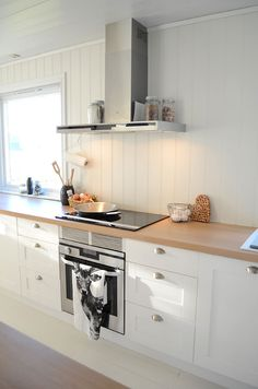 Country kitchen with modern touches in the form of sleek stainless steel. From a farmhouse in Ryfylke, Norway.