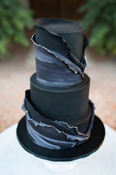 Modern black and navy fondant wedding cake with marble texture, torn detail and metallic edging | Jasmine Skye Photography