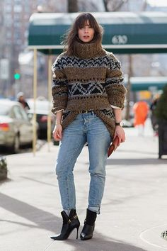 For All You People Who Hate Coats, Here's Your Cold-Weather Styling Move #refinery29  http://www.refinery29.com/oversized-turtleneck-sweater#slide-4  The one-handed tuck gives a bulky sweater some shape....